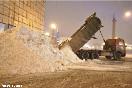 Россия, Санкт-Петербург. Снегоуборочная техника на улицах города. На снимке: уборка Дворцовой площади